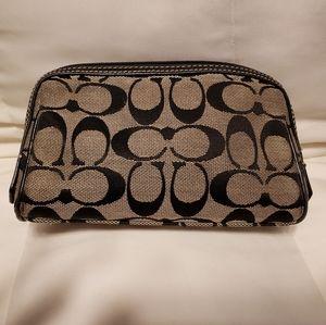 Black and grey Coach cloth makeup/accessorie bag